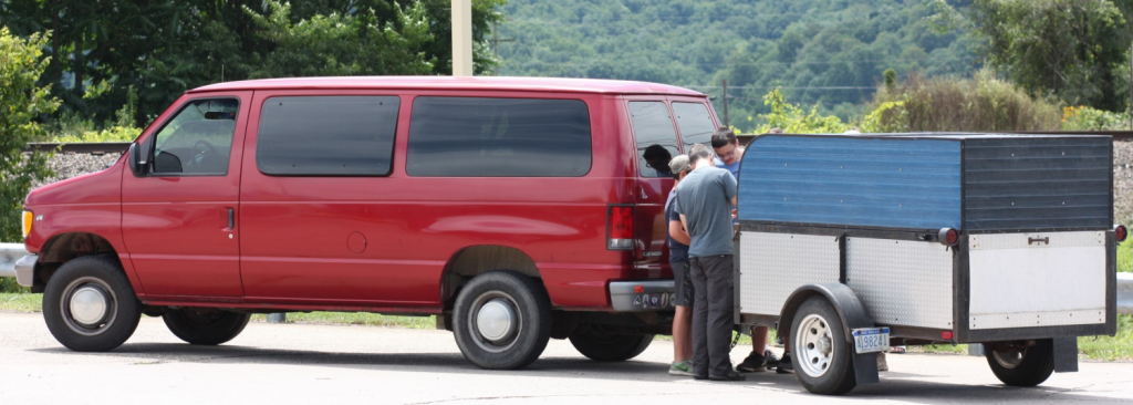 Red Van with Guys working on Trailer